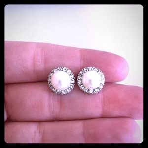 Faux diamond and pearl earrings.